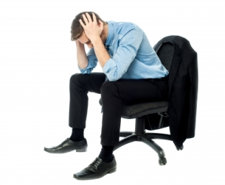 man in chair stressed